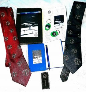 MM Club ties books pens and magnets