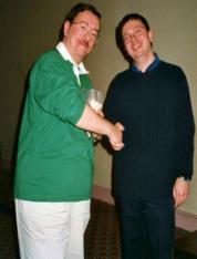 Carlisle - 2000 Kevin Ashman receives the Mugnum trophy from Gavin Fuller