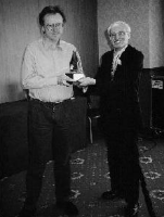Bristol 2001 - Howard Pizzey receives the Mugnum trophy from Peter Chitty