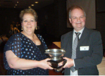 Durham 2016 - David Cowen receives the Magnum trophy from Ann Hegarty