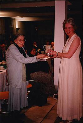 Harrow 1997 - Kathryn Johnson receives the Magnum from the first Mastermind champion Nancy Wilkinson
