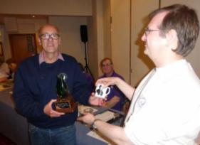 Shrewsbury 2014 Mugnum winner John Edwards receives his mug from Ken Emond