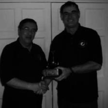 Southampton 2012 Mel Kinsey presents the Mugnum trophy to Kevin Ashman